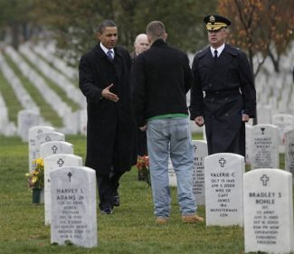 President Barack Obama, left, and Gen. Karl Horst, right, greet a visitor to Section 60 during an unannounced visit, Wednesday, Nov. 11, 2009, at Arlington National Cemetery in Arlington, Va. (AP Photo/Pablo Martinez Monsivais)