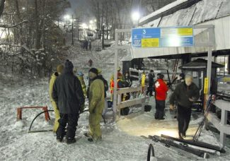 This Dec. 17, 2009, photo shows first responders after they were called to the scene of a ski lift accident at Devil's Head Resort near Merrimac, Wis. Officials said the resort's ski lift was heading up the hill as usual when it suddenly stopped and started moving backward, injuring at least a dozen people. (AP Photo/Baraboo News Republic, Todd Krysiak)