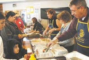 Summit Daily file photo/Mark FoxRotary volunteers served dinner at the Elks Lodge last April. Since then, the free community dinner has grown tremendously.