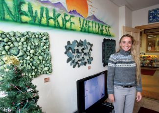 Dominique Taylor/Vail DailyKim Barbieri, owner of the Vail Valley's New Hope Wellness Center, stands in waiting room of her dispensary which is decorated with local artwork Tuesday in Edwards.   The New Hope Wellness Center was the first of five marijuana dispensaries to open in Eagle County this past year.