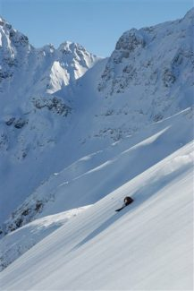 """In this undated photo from Silverton Mountain in Silverton, Colo., a skier slides down deep powder snow in an area of the mountain known as the """"nightmare bowl.""""  (AP Photo/Silverton Mountain,Aaron Brill)**NO SALES**"""