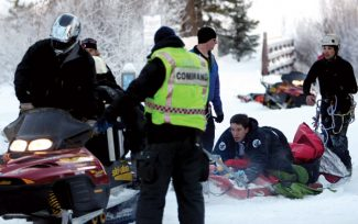 Dominique Taylor/Vail DailyRescuers in East Vail bring an injured ice climber down on a sled Tuesday after he fell about 100 feet