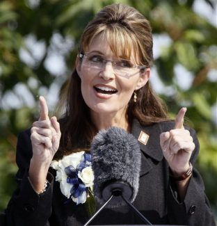 FILE - In this July 26, 2009 file photo, Alaska Gov. Sarah Palin gestures during her resignation speech in Fairbanks, Alaska. Palin is taking her conservative message to Fox News. An attorney for the former Alaska governor and Republican vice presidential candidate says Palin will provide some type of commentary for the cable network. (AP Photo/Al Grillo, File)