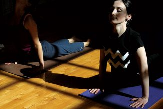 Kristin Anderson/Vail DailyJanet Satuchieva, right, practices yoga during the Vail Athletic Club's power hour yoga class Monday in Vail.