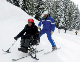 Dominique Taylor/Vail DailyOutdoor TV show host Tred Barta, right, enjoys the feeling of being back on skis and back on the mountain as he skis down Vail Mountain with ski instructor Chris Werhane Saturday in Vail.