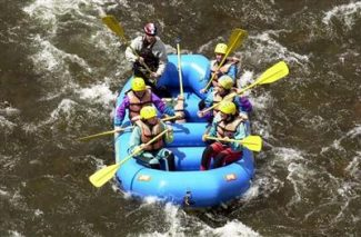 Denver PostA group of students rafts on the Arkansas River near Parkdale en route to Royal Gorge. The property rights/river use fight will probably go to voters in November.