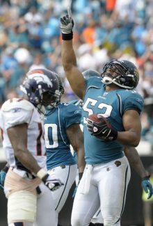 Jacksonville Jaguars linebacker Daryl Smith, right, celebrates after intercepting a pass intended for Denver Broncos receiver Eddie Royal, left, to seal the victory at the end of the second half of an NFL football game in Jacksonville, Fla., Sunday, Sept. 12, 2010. The Jaguars won 24-17. (AP Photo/Phelan M. Ebenhack)