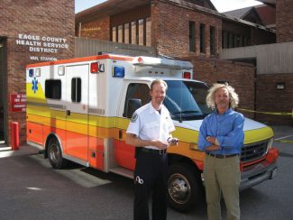 Special to the DailyEagle County Ambulance District paramedic Chris Marsh hands Luc Pols the keys to an ambulance that Pols will drive to Jacksonville, Fla., on its way to Cane, Honduras. The ambulance will be hauled on a Navy ship to Cane, Honduras.