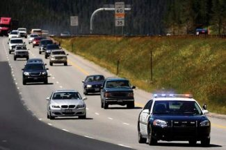 Denver Post file photo / Craig F. WalkerA pace car leads traffic during the rolling speed harmonization testing on Interstate 70 between Silverthorne and the Eisenhower/ Johnson Memorial Tunnel Aug. 13. CDOT launched the program officially for the first time Sunday.