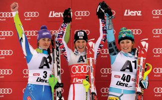 Austria's Marlies Schild, center, winner of an alpine ski, women's World Cup slalom, celebrates on the podium with second placed Tina Maze, of Slovenia, left, and third placed Mikaela Shiffrin, of the United States, in Lienz, Austria, Thursday, Dec. 29, 2011. (AP Photo/Giovanni Auletta)