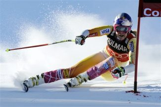 Lindsey Vonn, of the United States, powers past a gate on her way to win an alpine ski, women's World Cup super-G, in Cortina D'Ampezzo, Italy, Sunday, Jan. 15, 2012. American Lindsey Vonn has won a World Cup super-G to take sole possession of third place on the overall all-time wins list. Vonn clocked 1 minute, 26.16 seconds down the Olympia delle Tofane course Sunday. (AP Photo/Alessandro Trovati)