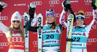 Germany's Maria Hoefl-Riesch, center, winner of an alpine ski, women's World Cup super-combined, celebrates on the podium with second placed Lindsey Vonn, left, of the United States, left, and third placed Austria's Nicole Hosp, in St. Moritz, Switzerland, Sunday, Jan. 29, 2012. (AP Photo/Armando Trovati)