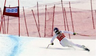Lindsey Vonn, of the United States, speeds down the course on her way to win an alpine ski, women's World Cup downhill, in St. Moritz, Switzerland, Saturday, Jan. 28, 2012. (AP Photo/Marco Trovati)