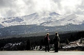 AP file photoTourists are checking out snow-covered Mount Holly Cross from Vail summit on Oct. 12, 2010.