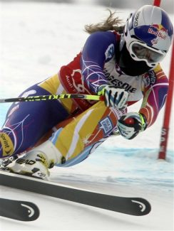 Lindsey Vonn, of the United States, speeds down the course on her way to win an alpine ski, women's World Cup downhill, in Garmisch-Partenkirchen, Germany, Saturday, Feb. 4, 2012. Vonn captured her 50th World Cup career victory by winning the downhill on the demanding Kandahar course on Saturday. The American is third on the all-time list, behind Annemarie Moser-Proell of Austria with 62 victories and Vreni Schneider of Switzerland with 55. Vonn now has 25 downhill wins, second behind Moser-Proell's 36. (AP Photo/Marco Trovati)