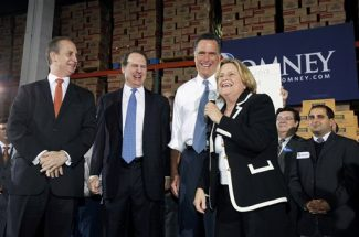 FILE - In this Nov. 29, 2011 file photo, Republican presidential candidate, former Massachusetts Gov. Mitt Romney, second from right, shares a laugh during a campaign stop in Medley, Fla. From left are, Rep. Mario Diaz-Balart, R-Fla., former Florida Rep. Lincoln Diaz-Balart, Romney and Reps. Ileana Ros Lehtinen, R-Fla. Four years ago, Florida crushed Romney's presidential campaign. This time, the GOP front-runner is working to ensure the state seals his fate as his party's presumptive nominee _ regardless of what happens in South Carolina's primary on Saturday. His political machine has been grinding in Florida for months. And the former Massachusetts governor has been aggressively trying to win over tens of thousands of absentee voters, while blanketing the state's television airwaves and wooing local evangelical leaders. (AP Photo/Wilfredo Lee, File)