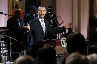 President Barack Obama welcomes guests during the White House Music Series saluting Blues Music in recognition of Black History Month, Tuesday, Feb. 21, 2012, in the East Room of the White House in Washington. (AP Photo/Pablo Martinez Monsivais)