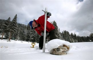 Frank Gehrke, chief of snow surveys for the Department of Water Resources,  checks the snowpack depth during the snow survey near Echo Summit Calif., Tuesday, Feb. 28, 2012. Despite recent storms the survey showed the snow pack to be only 17.7 inches deep with a water content of only 3.9 inches_ which is only 16 percent of normal for this location at this time of the year. (AP Photo/Rich Pedroncelli)