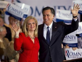 Republican presidential candidate, former Massachusetts Gov. Mitt Romney, right, and his wife Ann wave to a crowd during a election night rally in Schaumburg, Ill., Tuesday, March 20, 2012.  (AP Photo/Steven Senne)