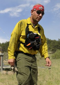 This June 15, 2012 photo shows Michael Maher  at the Shambhala Mountain Center in Red Feather Lakes, Colo.  Deputies arrested Maher, 30, of Denver, Sunday, June 17, 2012,  on charges including theft and impersonating a firefighter. The sheriff's department said Maher was driving through the fire zone with phony firefighter credentials and a stolen government license plate. His truck was later seen near a bar in Laporte, and investigators said they found a gun and stolen property in the vehicle. (AP Photo/The Denver Post, Karl Gehring)  MAGS OUT; TV OUT; INTERNET OUT
