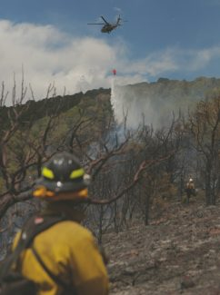 Dominique Taylor/dtaylor@vaildaily.comA helicopter drops water on a wildfire near Eagle Friday afternoon. The fire was about 80 percent contained as of 4 p.m.