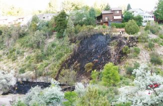 Jeff Caspersen Post IndependentGlenwood Springs firefighters successfully stopped a wildfire Wednesday afternoon before it reached homes in south Glenwood.