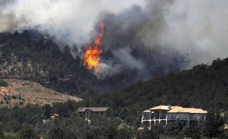 The Waldo Canyon wildfire continues to grow in Colorado Springs, Colo, Tuesday, June 26, 2012. Teller County officials warned residents east of U.S. 24 and north of the El Paso/Teller County line to be prepared to leave. (AP Photo/The Denver Post, Hyoung Chang)