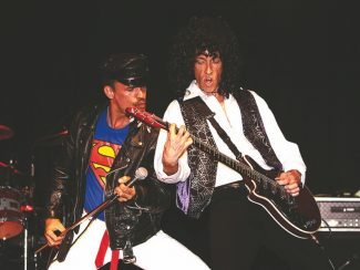 Special to the DailyMike McManus (right), as Brian May, plays the quitar while vocalist Gregory Finsley (left) acts as Queen's lead singer Freddie Mercury in the Queen tribute band Queen Nation.