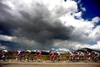 The large peloton heads makes their way towards Gunnison with thunderheads looming in the distance. The Pro Cycling Challenge's stage 1 kicked off today August 23rd, 2011, in the small town of Salida.  It wound 99.3 miles through Monarch Pass, Gunnison, Crested Butte and ended on Mount Crested Butte.  Team Radioshack's Levi Leipheimer won the first stage. Helen H. Richardson, The Denver Post