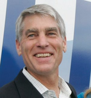 Rep. Mark Udall, D-Colo., with his daughter Tess, greets supporters with a thumbs up at one of his campaign offices in Denver, Colo., Tuesday, Nov. 4, 2008.  (AP Photo/Ed Andrieski)