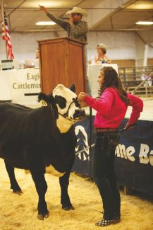 Jacey Schlegel auctions her steer during Saturday's 4-H junior livestock auction.