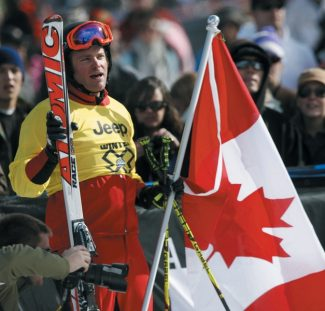 Chris Del Bosco, of Vail, Colo., who is also a Canadian citizen, holds a Canadian flag after winning the skier X finals at the Winter X Games at Buttermilk Mountain outside Aspen, Colo., on Sunday, Jan. 31, 2010. (AP Photo/David Zalubowski)