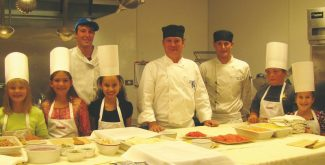 """Eagle County fifth graders will compete for the most nutritious, creative recipes at the """"Little Foodies in the Kitchen"""" Contest.  Winners will attend cooking classes with star Vail chefs like Chef Douglas Dodd (pictured, center).  Deadline for recipe entries is Sept. 21."""
