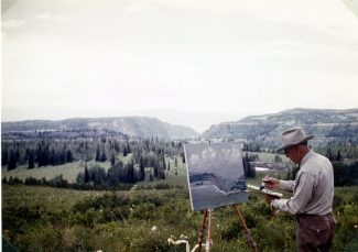 Special to the DailyThe late rancher-artist Frank Gates works on a landscape painting. Gates' work frequently won top prizes in regional art shows.