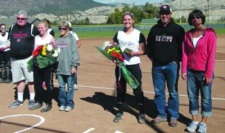 Marta  Ellsworth | Special to the DailyEagle Valley softball's Ally Zehring and Megan Osteen are honored on Senior Day before their game against Aspen Saturday in Gypsum. The Devils beat the Skiers, 18-0.
