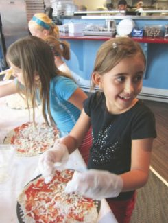 "During ""Family Week"" kids are told they definitely can play with their food.  Vail Restaurant Month ""Little Foodies in the Kitchen"" cooking classes, parties and adventures include the annual ""Pizza-Tossing Party!"" at Blue Moose Vail."