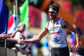 Special to the DailyJosiah Middaugh celebrates as he finishes first at the Xterra USA Championship in Snowbasin, Utah. He finished the triathlon in 2 hours, 26 minutes and 57 seconds.