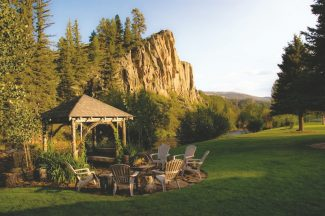 Special to the Daily/Ashlee BrattonWith stunning cliffs and the South Fork of the Rio Grande River in the background, the arbor at the Arbor House Inn is a popular spot for outdoor weddings during the summer.