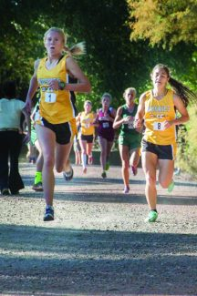 Bob Shearon | Special to the DailyBattle Mountain's Val Constien (1) and Mandy Ortiz (8) drive toward the finish at Wednesday's regional meet at Delta. The Huskies girls cross country team captured back-to-back regional titles.