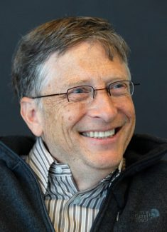 In this photo taken Wednesday, Jan. 18, 2012, Bill Gates smiles while being interviewed in Kirkland, Wash. Gates has a terse response to criticism that the high-tech solutions he advocates for would hunger are too expensive or bad for the environment: Countries can embrace modern seed technology and genetic modification or their citizens will starve. (AP Photo/Elaine Thompson)