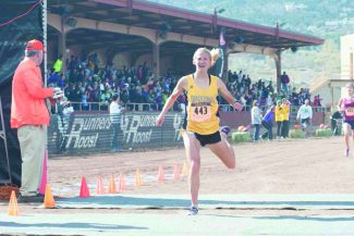 Bob Shearon | Special to the DailyBattle Mountain's Val Constien crosses the finish line, finishing fifth at Saturday's state cross country meet.