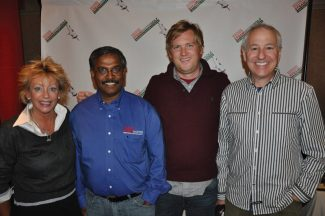 Cathy Ethington, Steammaster CEO Raj Manickam, Chad Holtz and Mark Bricklin are excited about Steammaster's presentation of four $10,000 checks to local causes at Apres Expo in Beaver Creek.