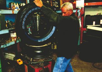 Justin McCarty / jmccarty@vaildaily.comOwner of Down Valley Tires, Cicero Da Silva prepares to mount a tire onto a wheel Tuesday in Gypsum. With a storm coming to Colorado which left large deposits of snow in California and Utah, people are rushing to get their snow tires installed on their vehicles.