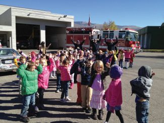 "Kindergartners at Edwards Elementary School have been learning about ""community"" and all of the important people it takes to make our community work. Thank you, Eagle River firefighters, for a great walking adventure to the fire station, for telling us about your jobs and for letting us check out your cool trucks!"