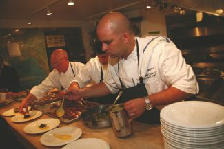 Special to the Daily / David BraunsteinGrouse Mountain Grill Executive Chef David Gutowski plates one of six courses in the James Beard House kitchen. The Beaver Creek restaurant chef was invited to present a dinner at the famed establishment nearly nine months in advance.