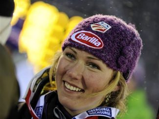 Mikaela Shiffrin, of the United States, smiles after finishing third in a alpine ski, women's World Cup Slalom, in Levi, Finland, Saturday, Nov.10, 2012. Olympic champion Maria Hoefl-Riesch of Germany overcame a nagging hip injury and local favorite Tanja Poutiainen on Saturday, putting down a blazing second run to overtake the Finn and win the first women's World Cup slalom of the season. (AP Photo/Giovanni Auletta)