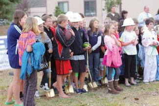 Eagle County Charter Academy students donned hard hats and grabbed shovels during the groundbreaking for their new building. Construction is scheduled to be completed next July.