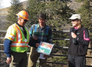 Andy Garcia, of CDOT, receives his award from Scott Schlosser and Greta Blamire, of the ECO Trails Committee.