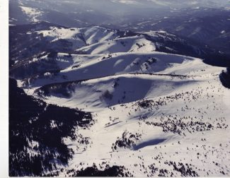 When Earl Eaton guided Pete Seibert up the mountain for the first time in March 1957 and looked out from the top, this was their view of the Back Bowls. The first people from Aspen Earl took up there said the back bowls would never be any good for skiing.