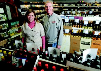 Dominique Taylor/dtaylor@vaildaily.comWest Vail Liquor Mart owners Tom, right, and Laurie Mullen, left, celebrate their store's 40th anniversary this season.